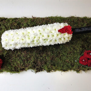 Cricket bat themed floral arrangement
